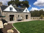 The cottage has new double glazing, central heating and patio doors into the enclosed garden
