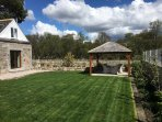 The patio with gazebo allows you to enjoy the outdoors and amazing scenery