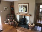 The dining room also has a wood burning stove to keep you cosy in the winter months