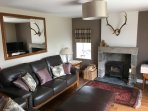 The newly refurbished sitting room has a wood burning stove, and a TV with DVD player