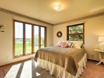 Admire the view from this plush queen bed.