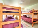 This bedroom features 2 twin-over-twin bunk beds, perfect for kids.