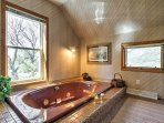 Soak away your cares in this luxurious jet tub.