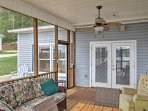 The screened-in porch is the perfect spot to sip your morning coffee.