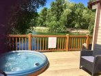 Prime lakeside location with private hot tub and private fishing peg.