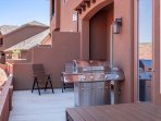 Patio with BBQ and large picnic table sits 8