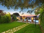The garden and the swimming pool by the sunset