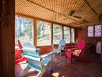 Relax on the enclosed sunporch and enjoy the view.