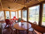 The enclosed sunporch is perfect for playing games or watching wildlife.