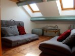Crog loft/playroom/bunk room.  Contains 2 floor sofas/double futons.  TV with DVD player