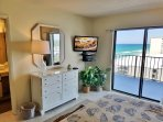 King size master suite with a view and private access to the balcony.