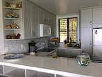 New light-filled kitchen has a view of the beach, and everything you could need.