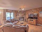 Cuddle up next to the fireplace in the living area while watching the flat-screen cable TV.