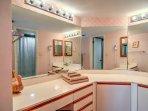 The master bedroom also includes a private en suite bathroom.