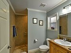 The full bathroom features a spacious walk-in shower.