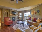With a gas fireplace, Apple TV and comfortable couches, the living area is the perfect spot to lounge during your ...