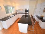 Spacious Kitchen with Island & Granite Benchtops