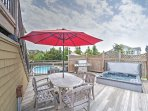 The main level, wrap around deck provides unobstructed views from the outdoor grilling area, hot tub, private, heated...
