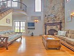 Through the lower-level entrance, you are greeted by a grand staircase and accent wood burning fireplace set into a...