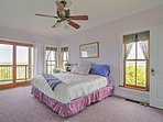 The first-floor master bedroom with full master bath offers a flat-screen TV and stunning views!