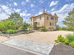 Turning into the private driveway guests are welcomed to a bright castle-esque home with dramatic stone chimney and...