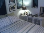 Clean comfortable guest room. Stocked with clothes iron, ironing board, snacks & laptop ready desk.