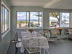 The enclosed porch offers fantastic views.