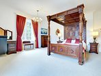 Master bedroom with hand carved, mahogany Four Poster bed