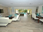 Open Living Offers Three (3) Leather Sofas + HD TV + Direct Pool Lounge Access!