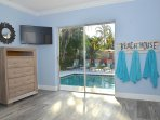 Private Master Suite (Queen Bed) Features En Suite Bath + LED HD TV + Poolside Lounge Access...
