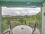 Gather around the 4-person round table on the outdoor covered deck, perfect for hosting a poker night!