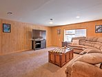 The rec room offers sectional seating and flat-screen TV.