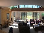 Great Room with atrium, skylights, and wood burning fireplace.