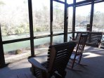 Screened in Porch with Rockers and Porch Swing Over Looking the River