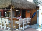 The Tiki Bar is poolside at the Clubhouse and serves drinks and snacks