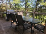 Back deck with table, chairs and Propane BBQ