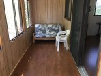Screened-in front porch with futon