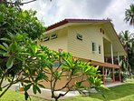 Our family home set in the tropical garden overlooking the beach