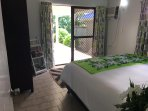 Downstairs bedroom with access to the verandah