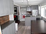 Incredible NEW kitchen. Not your average cottage kitchen! Seating for 8, door to the deck.