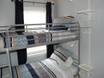 Second bedroom.  Each bunk has a reading lamp, storage and access to surge protected power.