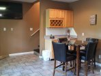 Media Room - 55' TV and table to play games. Gas logs, Mini fridge, sink.