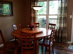 Dining area - large Lazy Susan makes sharing meal time easier and more fun.