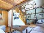 Family room on first floor has XL sectional, breakfast bar, woodturning stove and access to the deck