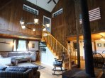 Classic post & beam construction with 27' ceilings that connects to the dining room and kitchen.