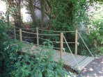 The cute wooden bridge over to the meadow