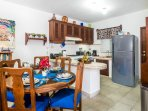 A well equipped kitchen with a new stainless steel refrigerator