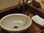 Japanese handmade washbowl on a natural camphor wood.