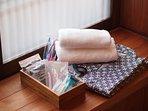 Towels, yukata( japanese pajama), tooth brush, hair brush, body towel, razor.
