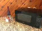 Kitchenette has a microwave, mini-fridge, toaster, coffee maker & more.